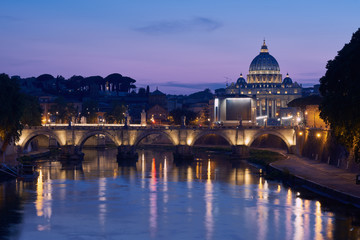 The blue hour view on gorgeous St. Peter's Basilica in the Vatican across the Tiber River in Rome, Italy