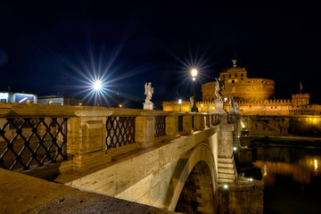 Ponte Sant'Angelo (Aelius Bridge)  across the Tiber River in Rome at night