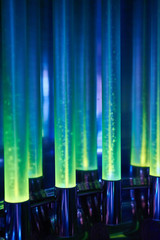 A beautiful yellow-green-blue neon light flows through the pipes