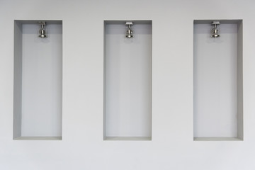 Empty niches in wall with spot lights photo