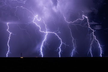 Lightning bolts strike from a monsoon storm near Willcox, Arizona.