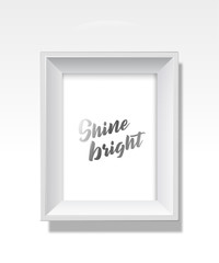 Vector golden background picture frame with Shine bright slogan.