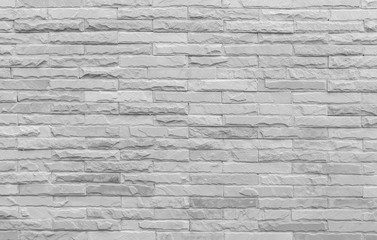 Old grunge retro style bricks wall background and texture.