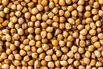 Top view chickpea groats as a natural food background. Concept of healthy vegetarian diet.