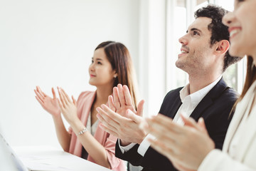 Business people clapping hands during meeting in office for their success in business work Wall mural