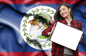 Woman holding blank board against national flag of Belize