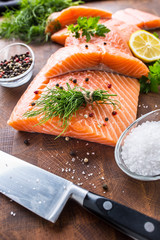Raw salmon fillet with dill lemon olive oil salt and pepper