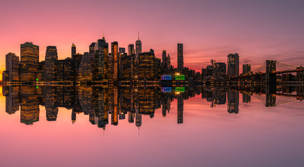 Lower Manhattan skyline reflection from the Brooklyn Bridge Park, New York City, USA