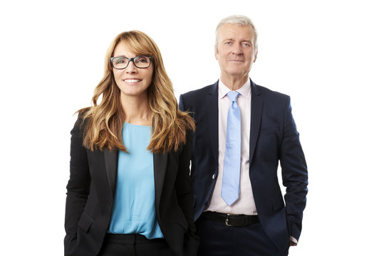 Business team studio shot. Portrait shot of two business people standing at isolated white background.