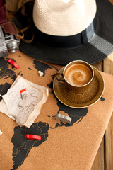 An old map, a camera, a hat, a fragrant morning coffee. Retro style photo. Plans for traveling. Copy space.