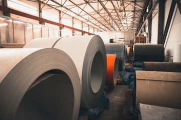 Roll of galvanized steel sheet close up, ironworks and metalwork manufacturing factory