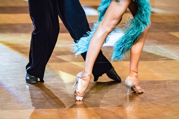 Dancing shoes feet and legs of female and male couple ballroom and latin