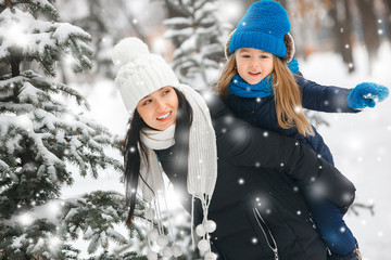 Pretty family having fun outdoors in winter time