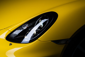 Car detailing series: Clean headlight of yellow sports car