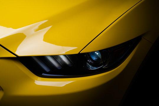 Car detailing series: Clean headlight of yellow sports car