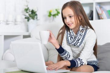little girl using modern laptop