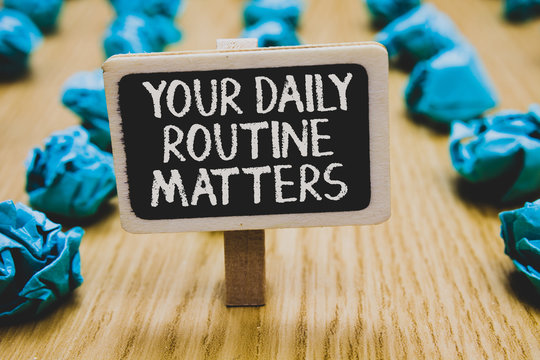 Handwriting text writing Your Daily Routine Matters.. Concept meaning Have good habits to live a healthy life Stand blackboard with white words behind blurry blue paper lobs woody floor.