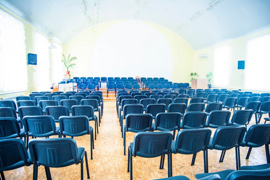 Chairs in the empty room for performances