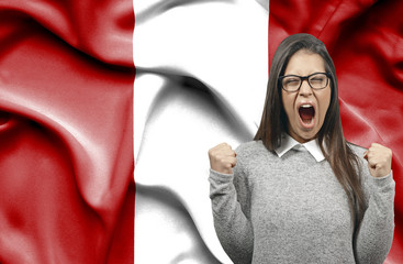Ecstatic woman holidng fists and screaming against flag of Peru