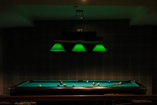 The pool table up lighted