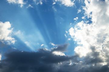 Sun rays bursting through the clouds