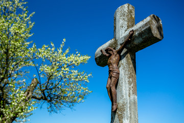 Rusted Jesus on the Stone Cross