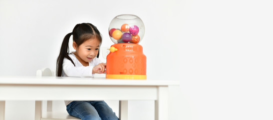Concept Family. Little girl playing toys with fun at home. Little children are playing happily.