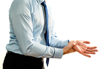 Wrist ache. Pain in the wrist and hand. Businessman is holding his aching hand. Too long computer work, hand fatigue, pain sensation. The concept of healthcare and medicine.