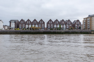 Old English houses along the Thames river