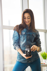 Young cute and smiling photographer and graphic designer woman at work in office