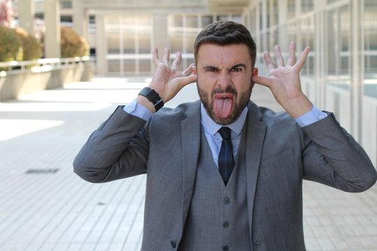 Childish businessman doing an obscene gesture