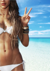 A happy tan girl at the beach holding up a peace symbol with blue sky's and crystal clear surf in the background. Room for text or copy space . Photo realistic 3d rendering