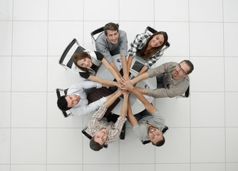 top view.successful business team by folding their hands togethe