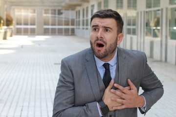 Businessman experimenting chest pain at work
