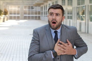 Businessman reacting dramatic in the office