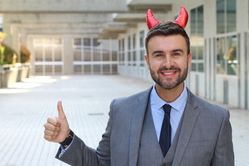 Evil businessman giving a thumbs up