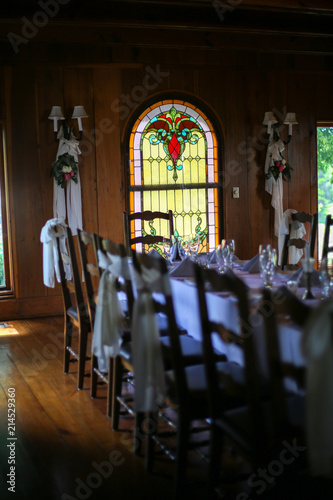 Intimate Wedding Reception Table Setting With White Table Cloth In A