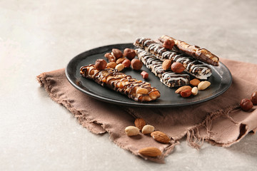 Homemade grain cereal bars with chocolate and nuts on plate