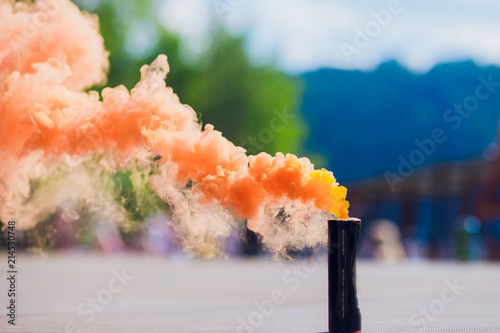 colorful orenge smoke bombs in action