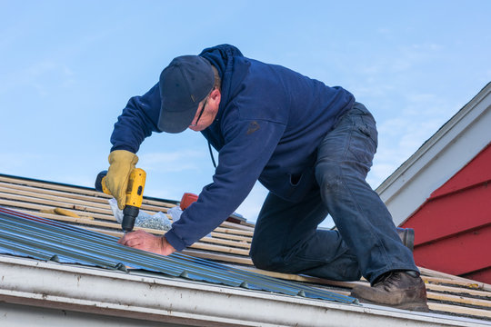 Man working on tin roof