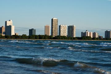 A cityscape of apartment buildings along Lake Michigan