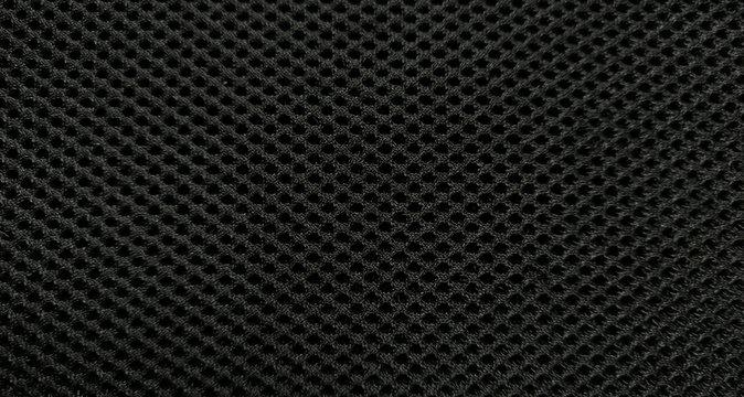Black nylon fabric pattern texture background.