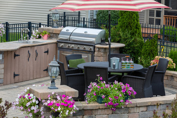 Brick patio with gas BBQ and dining seating Wall mural