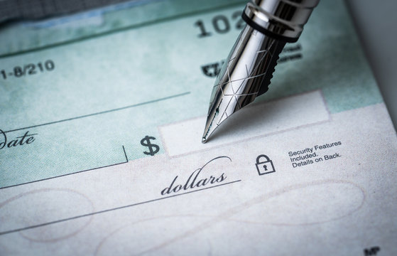 writing a check , making payments