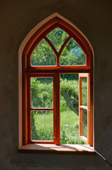 Arched window looking out to green landscape