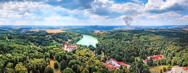 Panoramatic aerial photo of Konopiště chateau (castle) with surroundings landscape and fire in the horizon in Central Bohemian Region - Czech Republic from ultralight plane
