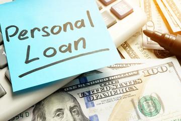Personal loan. Calculator, dollar bills and pen.