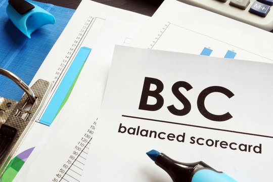 Documents about balanced scorecard BSC on a table.