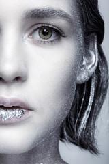 Closeup beauty portrait of young woman face
