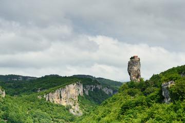 Georgia, Katskhi pillar. Man's monastery near the village of Katskhi. The orthodox church and the abbot cell on a rocky cliff.